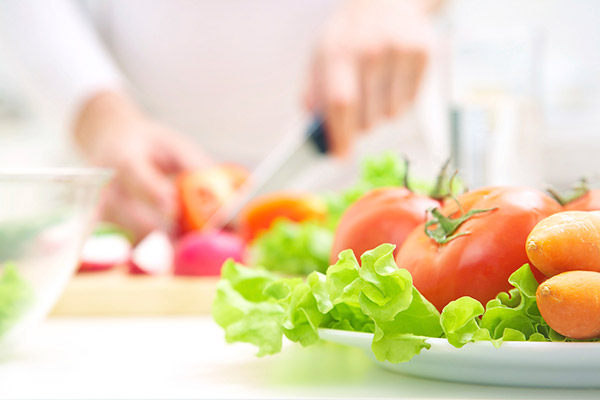 Nutritionist cutting vegetables