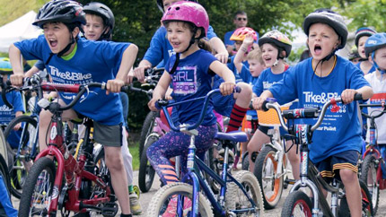 Kids on bikes at Cleveland Clinic Giving event