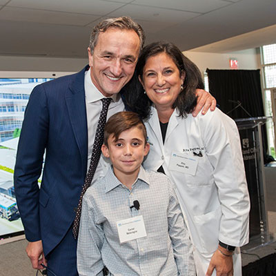 Cleveland Clinic CEO and President Tom Mihaljevic, MD, celebrates the opening of the new outpatient center on Sept. 14 with Cleveland Clinic Children's patient Daniel Melaragno and Cleveland Clinic Children's Interim Chair Rita Pappas, MD.