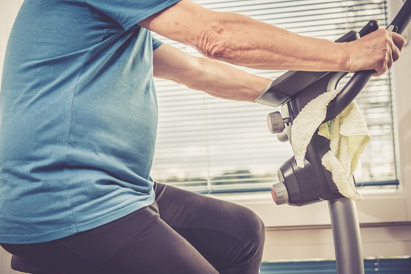 Older adult on exercise bike (Getty Images)