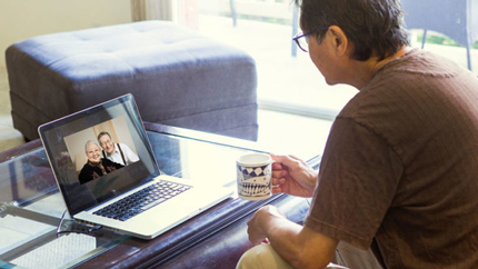 Man video chatting with parents
