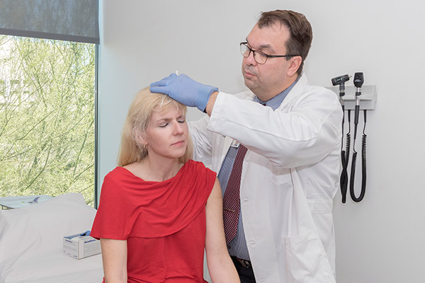 Zoltan Mari, MD performs a botulinum toxin injection.