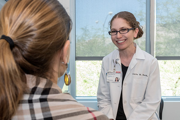 Carrie Hersh, DO discusses options with an MS patient at Cleveland Clinic Nevada.