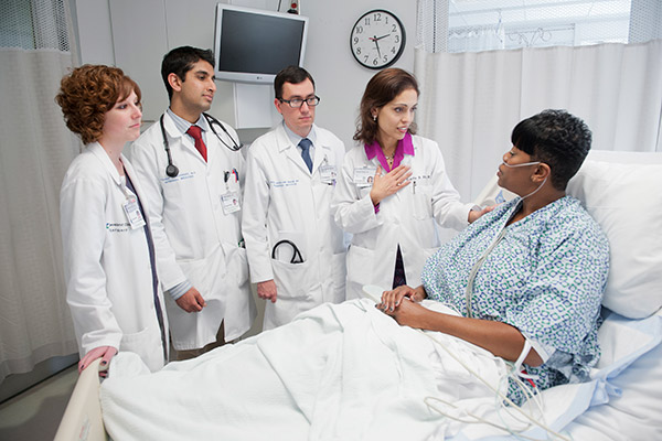 Cleveland Clinic caregivers practicing the R.E.D.E. to Round method during rounds with a patient