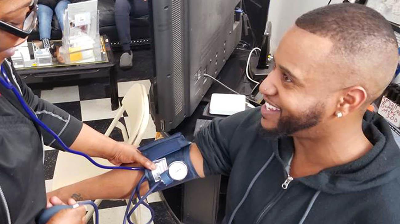 Blood pressure screening at Waverly Willis' barbershop