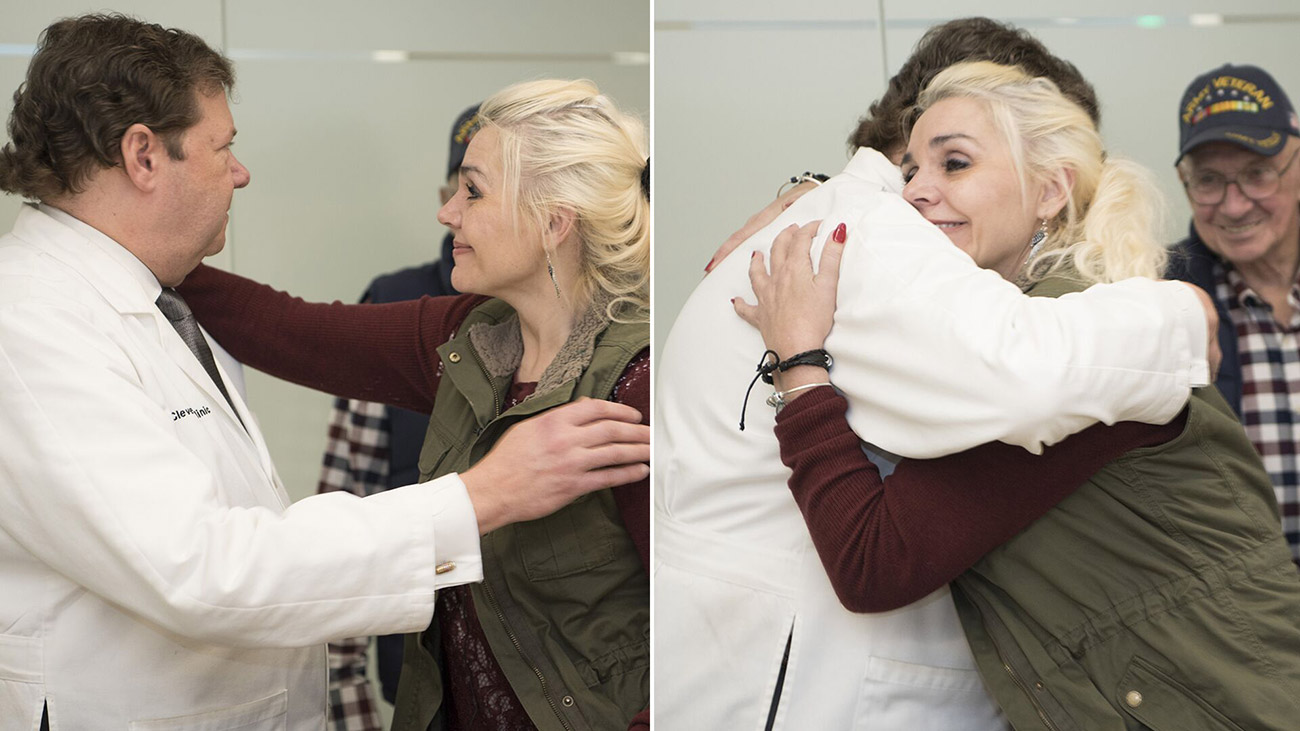 Rachel Given hugging Dr. Barnett, for the first time, after brain cancer treatment, 18 years ago.