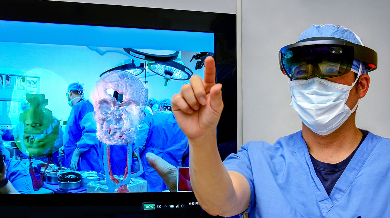 Kihyun Cho, M.D., a member of Cleveland Clinic's face transplant surgical team, uses HoloLens for preoperative face transplant surgery planning, for Katie Stubblefield's surgery. (Courtesy: Cleveland Clinic)