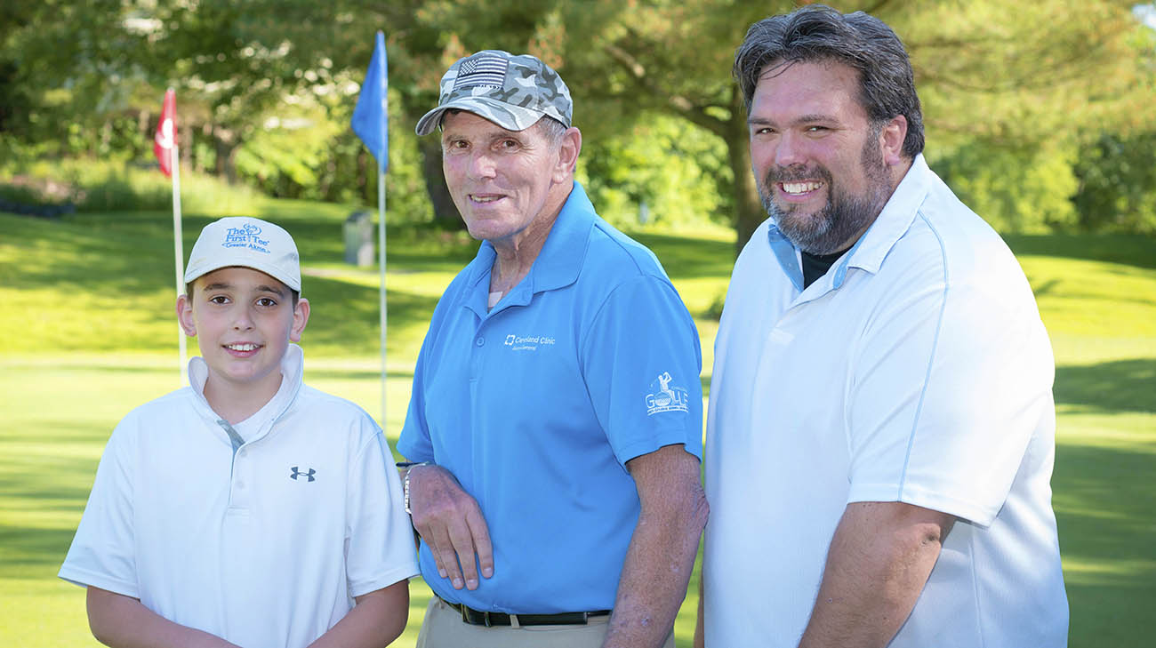 Vietnam veteran Charlie Morris golfs with his son and grandson at Challenge Golf.