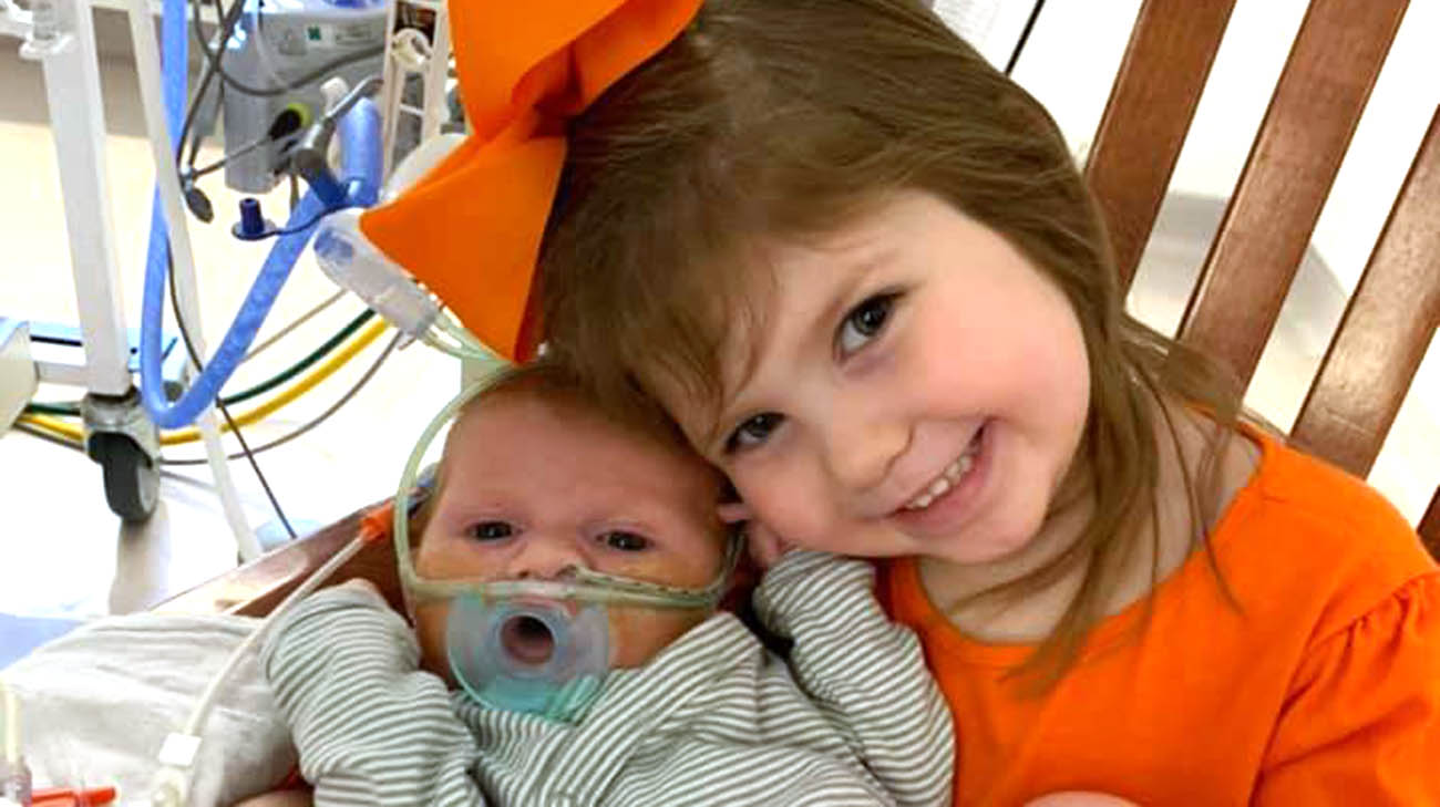 Carson with his sister Aubree, after surgery, at Cleveland Clinic Children's.