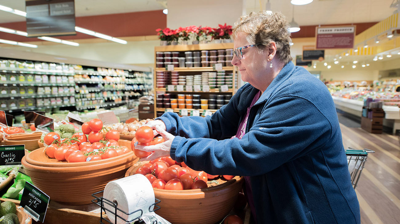 Pat Baskins shopping for vegetables