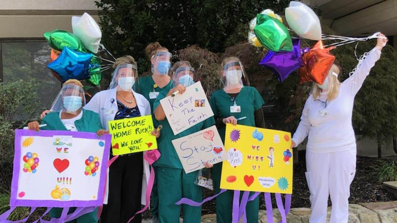 Cleveland Clinic caregivers gathered to welcome Dr. Rick Wilson, after he left the hospital.