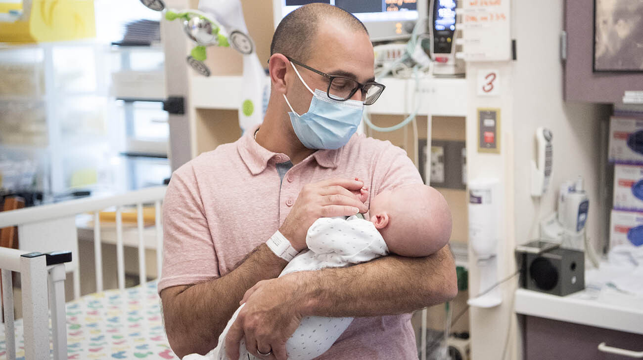 Frank holds Patrick in the NICU shortly before he was discharged from the NICU. (Courtesy: Cleveland Clinic)