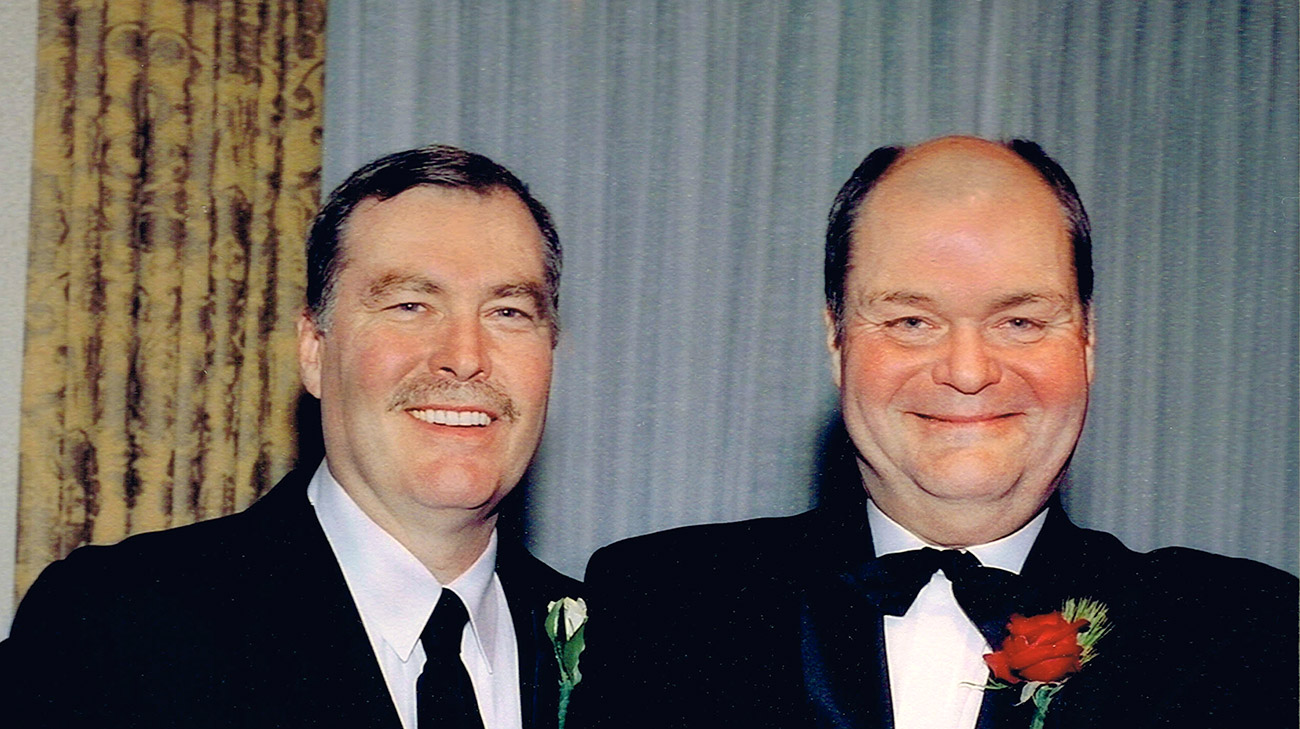 Bill (left) and brother John Grimberg (right) celebrating the wedding of Bill's son. (Courtesy: Judith Allen)