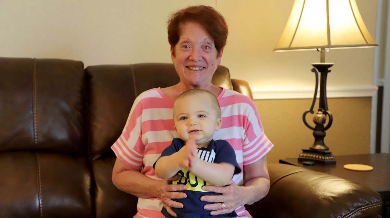 Peggy and her grandson, Asher, at his first birthday party. (Courtesy: Peggy Notman)