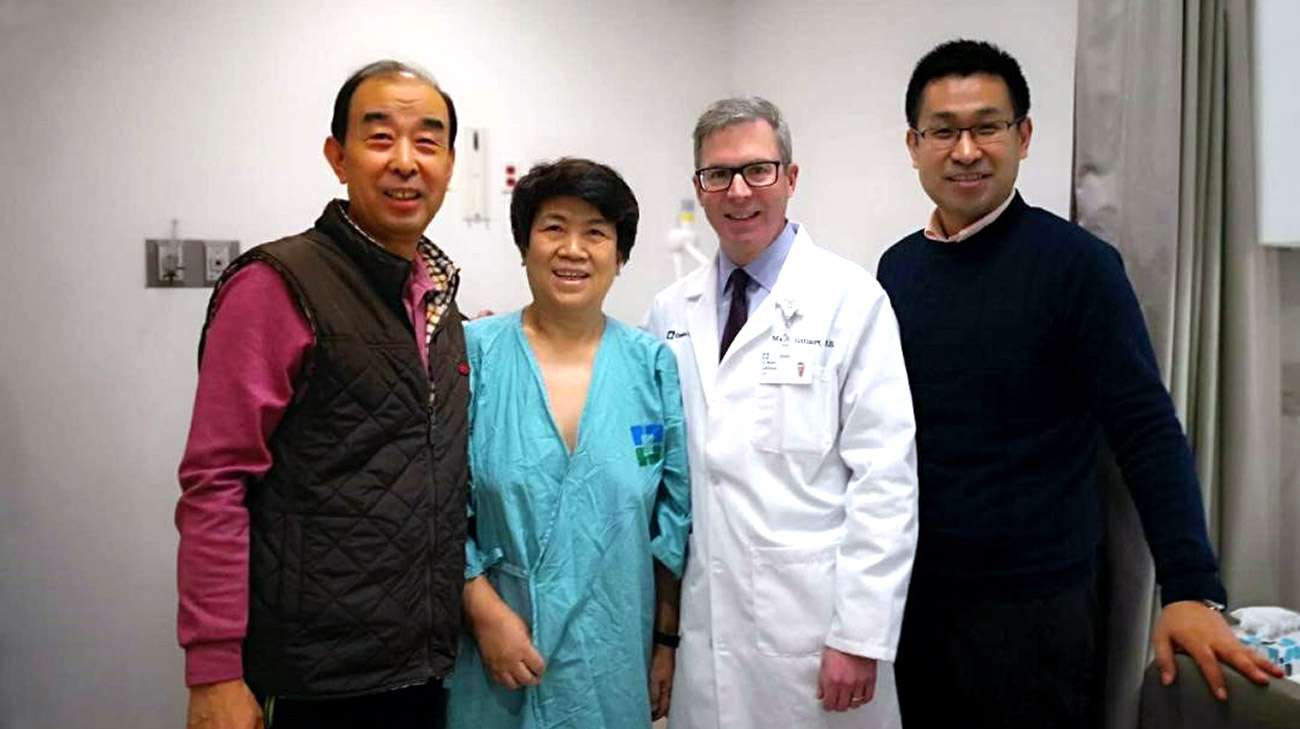 The Wu family's research about mitral valve surgery led them to Cleveland Clinic and Dr. Marc Gillinov. Pictured, left to right: Zhigang and Yuexian Wu; Marc Gillinov, MD; Xiaoyo Wu.
