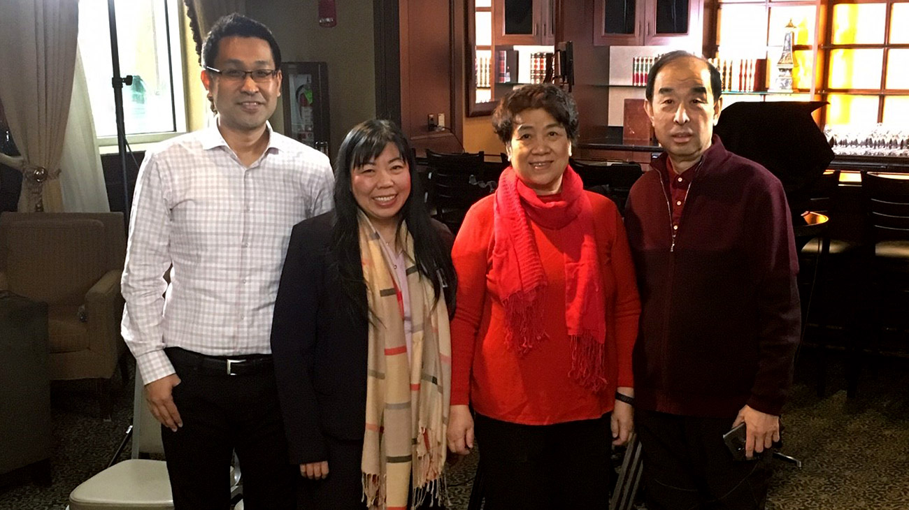 Yuehchi Weng, interpreter with Cleveland Clinic's Global Patient Services, established a connection with the Wu family and calmed their fears when they arrived from China. Pictured, left to right: Xiaoyo Wu; Yuehchi Weng; Yuexian and Zhigang Wu.