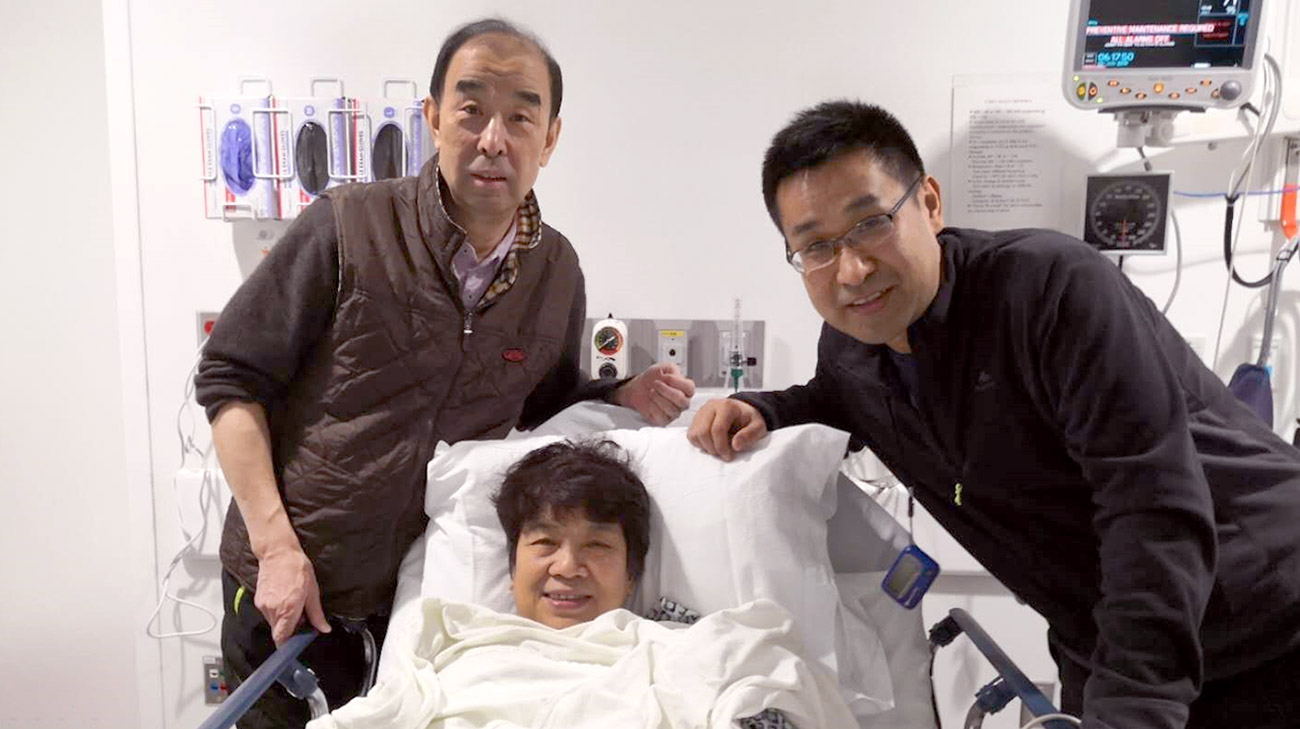 Yuexian Wu (center) underwent successful minimally invasive mitral valve repair surgery in January 2019. Her husband Zhigang (left) and son Xiaoyo (right) made the trip from Shanghai to Cleveland with her.