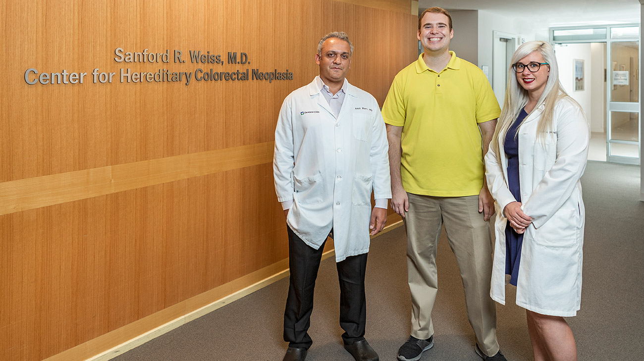 Michael Ambrose (center) travels from Washington, DC, for followup appointments with his care team, which includes surgeon Amit Bhatt, MD, (left) and nurse Caitlin Durnil, LPN (right).