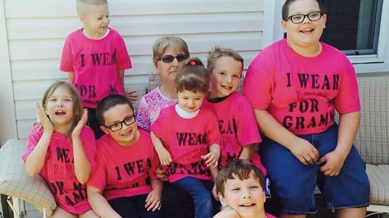 Jane with nine of her 19 grandkids who all made shirts to support her during breast cancer treatment