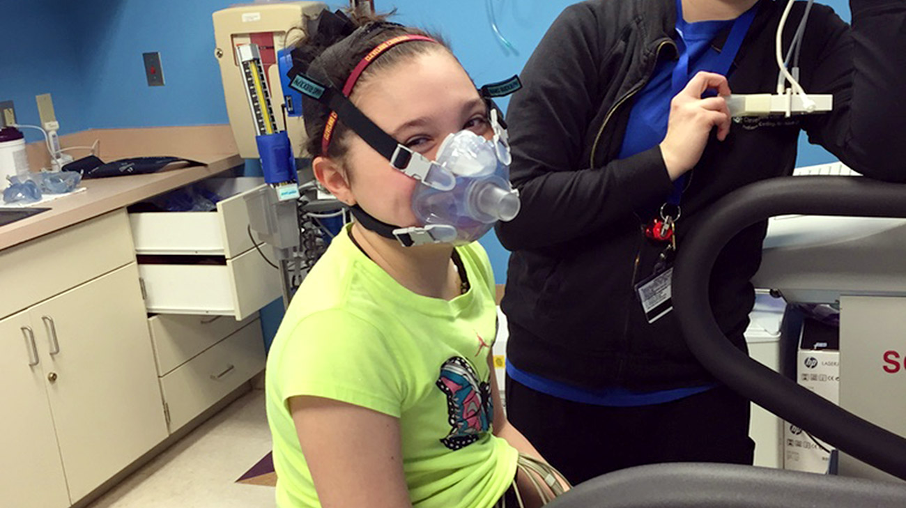 Sophia, months after being discharged, undergoing testing to ensure she's healthy enough to ride roller coasters with her family during vacation
