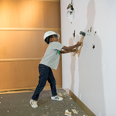 Cleveland Clinic Children's patient Julius Ivan Chatmon takes a big swing at the wall